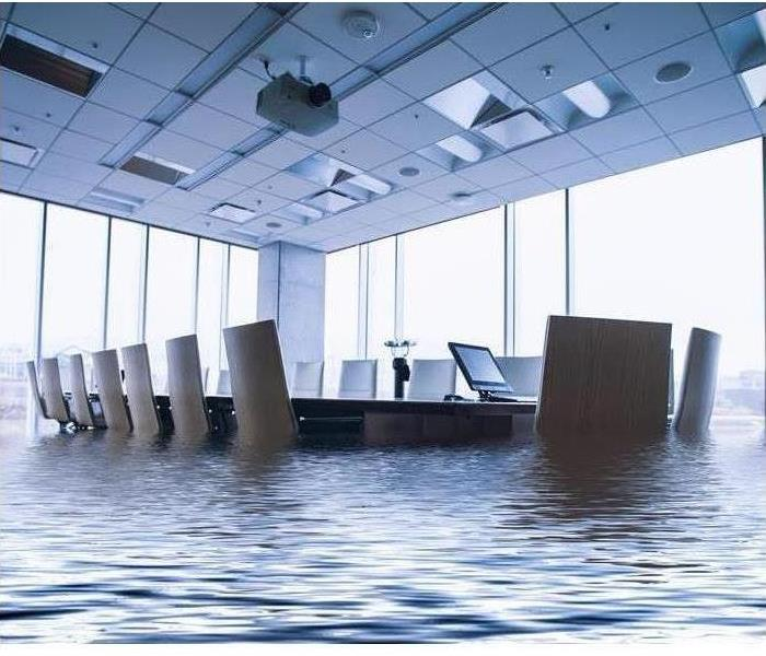 conference room table and chairs in two feet of water