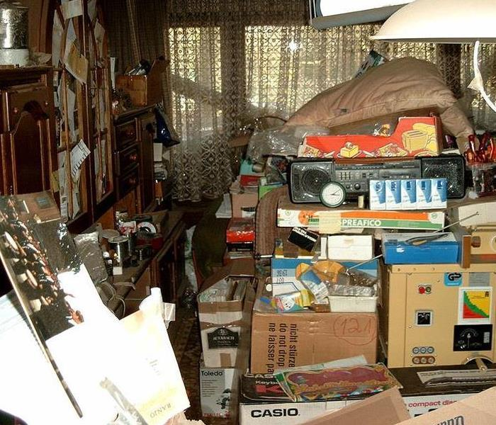 room overcrowded with belongings